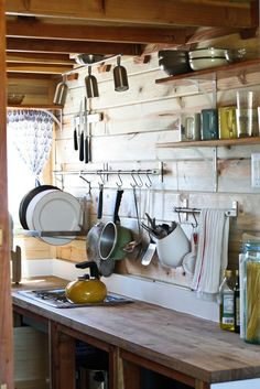 While people focus on the proper arrangement of items in cabinets and cabinet space I like the idea of creating a focus aesthetic on the intent of the room. It is also easy accessibility.