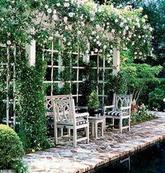 Secret Garden  A shallow pergola, thick with roses and jasmine, shades a seating area across the pool. Incorporating these plants into your outdoor room is a great way a add fragrant ambience to the space.