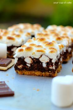 S'mores Bars (butter, graham crackers, sugar, dark or semi-sweet chocolate, whole milk or heavy whipping cream, cocoa pebbles or regular rice puff cereal, mini marshmallows)