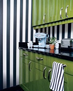 Black and white striped walls with green cabinets