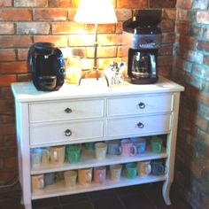 Coffee station in the living room!! One old chest of drawers, take drawers out & put mugs below.