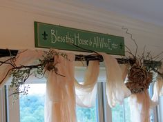 Country Cottage window treatment - made with tea-stained cheesecloth, twigs and burlap flowers