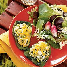 Roasted poblano chiles not only add some spice to this dish, they also serve as a container for the flavorful filling of corn, cilantro, garlic, scallions, and farmer and Cheddar cheeses.