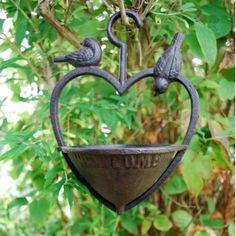 Heart-shaped cast iron bird feeder.