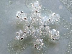 Bead snowflake ornament by Carolyn Saxby Textiles.