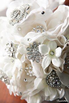White roses, stephanotis, and bling! #WeddingBouquet #JeweledBouquet  Jenifer Morris Photography