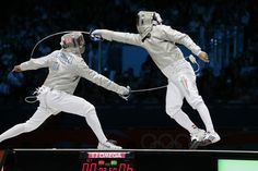 Italy's Diego Occhiuzzi, left, competes with Hungary's Aron Szilagy during the gold medal match in the men's fencing individual sabre at the 2012 Summer Olympics, Sunday, July 29, 2012, in London.