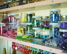You can use old baby food jars for bead storage! old baby food jars, idea, recycled jars, color, bead storage, storage jars, craftroom, craft room, button storag