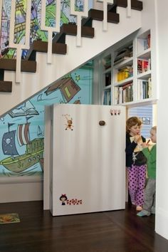a hidden playroom under the stairs