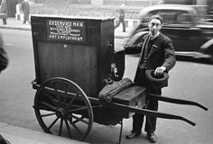 London, Oxford Street, World War II. An organ-grinder in London during the Blitz.