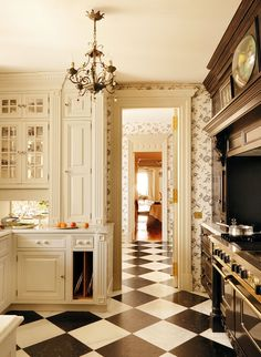 Classic black and white kitchen. Love the harlequin floor