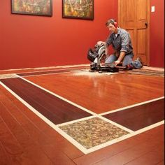 Mix and match colors of wood laminate flooring, add a few stone tiles as accents, and suddenly you've made an extraordinary wood floor for the same cost as an ordinary one.