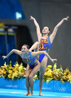 Synchronized Swimming Style: An Appreciation Post: Synchro costumes are cool because there's always a lot going on in them, and countries aren't afraid to get a little creative--the themes really ran the gamut. There were dragons (seen here, on Chinese competitors)...