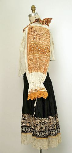 Wedding Ensemble.  Date: 1922. Culture: Slovak. Medium: cotton, silk, metal. Dimensions: Length at CB (a): 13 1/8 in. (33.3 cm). Length at CB (b): 15 1/2 in. (39.4 cm). Length (c): 33 in. (83.8 cm). Length (d): 32 3/4 in. (83.2 cm). Length (e): 8 7/8 in. (22.5 cm). Length (f–h): 122 1/4 in. (310.5 cm). Length (f–h): 38 1/2 in. (97.8 cm). Length (f–h): 30 5/8 in. (77.8 cm).