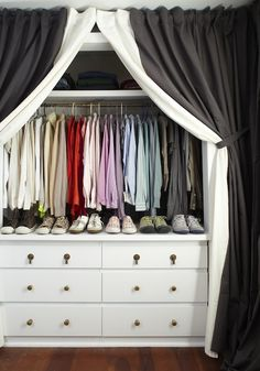 Meredith McBride Kipp: Gorgeous walk-in closet with black and white layered curtains hiding white cabinets ...