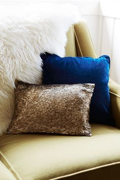 love the combinations of bright blue sparkly gold pillows, with a cozy white throw.