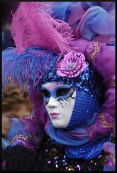 Full face and headpiece Mardi Gras mask.