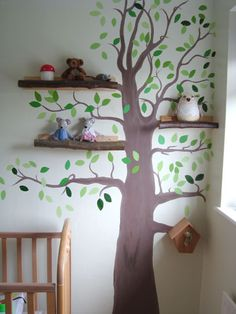 Tree painted on wall with branch shelves