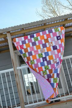 "5"" charm squares separated with 2.5"" x 5"" strips of Kona white cotton and offset the rows"