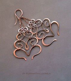 Simple and stunning - join intricate wire worked elements with split rings. A little note, I think that this design would work much better turned upside down. But it requires soldering the hinged wire.