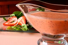 5 Star! Strawberry-Poppyseed Dressing. 1 cl garlic 1/8 slice of small purple onion 1/4 c sugar 1/4 c fresh strawberries, raspberries 1/3 c white vinegar 1/2 c extra light olive oil 1/4 tsp salt 1 tbsp poppyseeds. Put all ingredients (except poppyseeds) into a blender. Blend until entirely pureed. Stir in poppyseeds.  I made this two ways  Substituted a white Quince flavored Balsamic Vinegar, preferred this taste, or w/ white vinegar and a bit more tangy.  Subst. honey for sugar to make thicker
