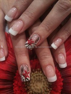 White acrylic tips with freehand nail art