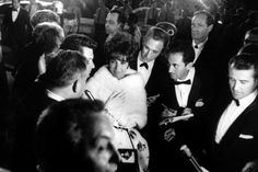 Elizabeth Taylor walks through a crowd of admirers at the Oscars in 1961 — the year she won her first Academy Award, for her role in BUtterfield 8.