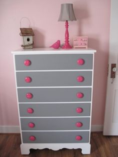 I'm not really crazy about the chest of drawers but I really like the pink lamp with the grey lamp shade.