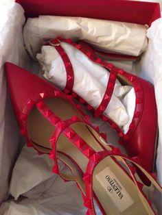Valentino studded red heels.