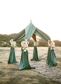 Get Tent frame and wrap your choice of fabric over, string lights, tie off with beautiful bouquets of flowers