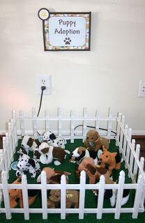 "puppy pen (could also do gift bags in a pen that people could ""adopt"" as they leave!)"