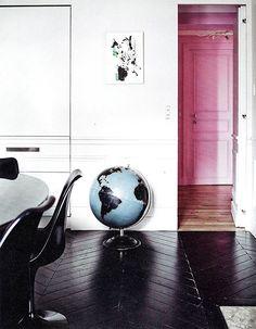 black floors, pink door