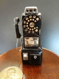 Sweet little dollhouse miniature pay phone - nice display item for a 1:12 scale garage or store