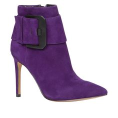 Bold purple booties are a fun change from black.