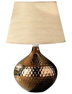 Hammered metal table lamp. £35.99  http://www.worldstores.co.uk/p/Hammered_Bronze_Table_Lamp.htm