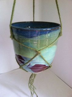 Wheel trown stoneware hanging planter with handmade jute hanger.