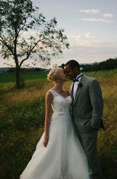 DB Bride Mary G. looked gorgeous on her wedding day in Oleg Cassini Style CKP421 from David's Bridal! #davidsbridal #rusticwedding #oneshoulderweddingdress