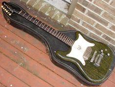 guitar shape, inner geek, guitar fetish, silver foxes, epiphon guitar