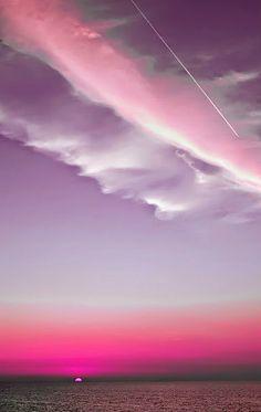 Pink skies over the ocean.