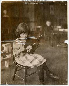 North School pupil reading, ca. 1910. Item # 10392 on Maine Memory Network