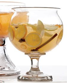 Mulled White-Wine Sangria        1 cup water      1/2 cup honey, preferably orange-blossom      Zest of 2 lemons, cut into long strips      1/4 cup fresh lemon juice (from 2 lemons)      4 whole star anise      4 cinnamon sticks      12 whole cloves      2 bottles dry white wine, such as Sauvignon Blanc      1 cup orange Muscat, such as Essencia      1 Golden Delicious apple, cored, halved, and thinly sliced      1 Bartlett pear, cored, halved, and thinly sliced      2 lemons, preferably Meyer, thinly sliced crosswise      12 kumquats, thinly sliced crosswise    Directions        Bring water, honey, lemon zest and juice, star anise, cinnamon sticks, and cloves to a simmer in a large saucepan over medium heat. Reduce heat to low, and cook for 15 minutes.        To serve cold: Mix spice mixture, wines, and fruit in a large pitcher. Cover, and refrigerate overnight. Transfer to a large punch bowl, and serve with ice. To serve hot: Heat spice mixture and wines in a large pot over low heat until heated through. Add fruit, and divide among mugs.