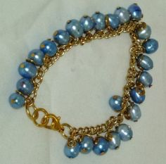 Dyed Freshwater Pearls Bracelet in a soothing blue on a gold plated chain. The bracelet has a Gold plated lobster claw clasp.