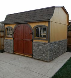 Dutch Colonial Shed with stone veneer, rounded wood door and arched wood windows--Vacaville, CA http://www.backyardunlimited.com/sheds/dutch-colonial-sheds
