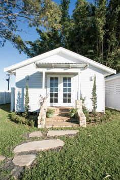 Charming little white house / cottage with small front porch and stone stairs and walk - Shannon Frike - Painted home exterior