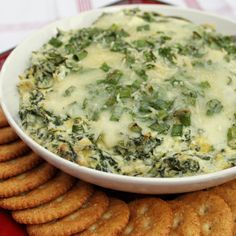 Cheesy Spinach and Artichoke Dip  This classic dip is so tasty it'll be the hit of the party. Made with three cheeses, this version is especially creamy and rich. Serve hot out of the oven with crackers.