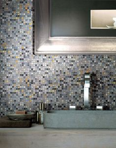 """Refined atmospheres produced by the crystalline light/dark combinations of Vetro Neutra Melange by Casamood.  The pictured glass mosaic """"Melange scuro"""" is a dark mix of grey shiny tesserae."""