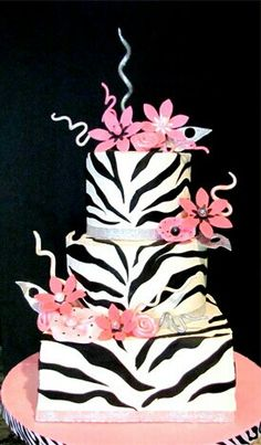 Luv The Cake design..  However I will do a round on top of a full sheet,  decorated like this, but with my own touches ;-)