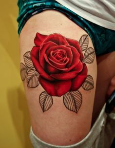 the most gorgeous tattoo rose ever tattoo idea, thigh tattoos, thighs, colors, rose tattoos, red roses, flower tattoos, flowers, leaves