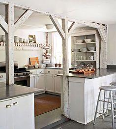 Open white farmhouse style kitchen, wooden beams