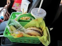 $1 shower caddy for when kids have to eat in the car. Good for car trips.